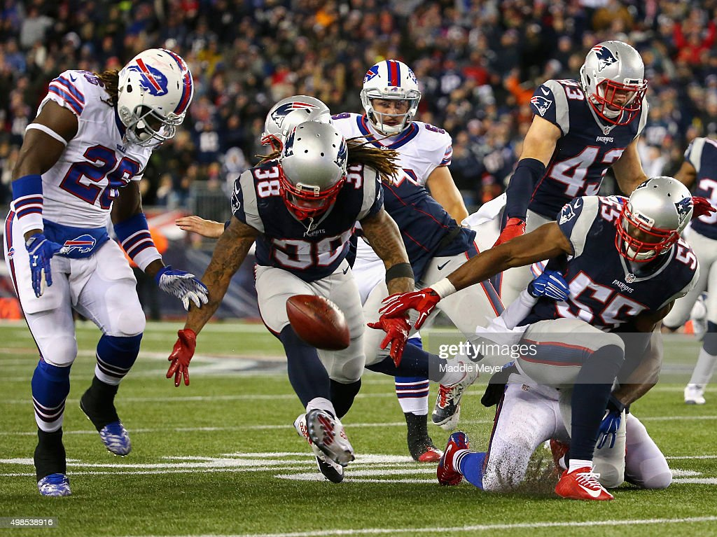Jerry Hughes #55 of the New England Patriots fumbles the ball during the fourth quarter against the Buffalo Bills at Gillette Stadium on November 23, 2015 in Foxboro, Massachusetts.