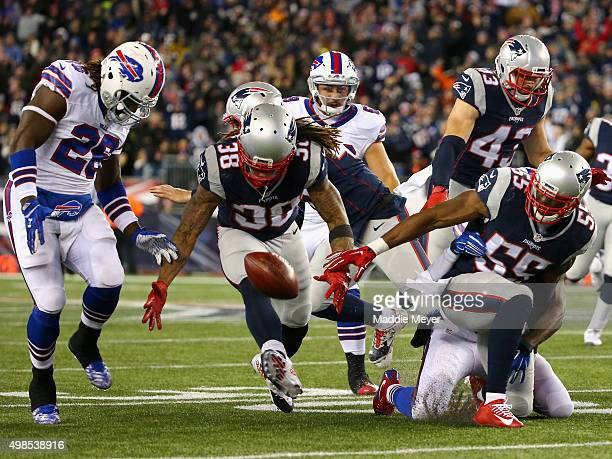 Jerry Hughes of the New England Patriots fumbles the ball during the fourth quarter against the Buffalo Bills at Gillette Stadium on November 23 2015...