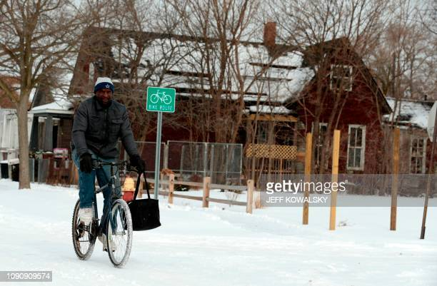 Jerry Jackson rides his bike on a cold day on Cochrane Street on January 29 2019 in Detroit Michigan Millions of Americans braced Tuesday for a...