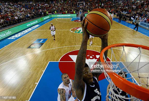 Jerry Jefferson of Triumph slams dunk as Hristo Nikolov of Szolnoki defends during the FIBA Europe EuroChallenge Final Four third place game between...