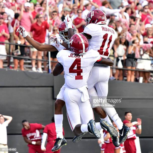 Jerry Jeudy and Henry Ruggs III of the Alabama Crimson Tide celebrates with DeVonta Smith after his scoring a touchdown against the Vanderbilt...