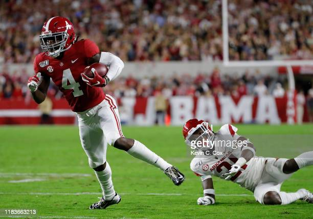 Jerry Jeudy of the Alabama Crimson Tide breaks this tackle by Montaric Brown of the Arkansas Razorbacks and rushes this reception in for a touchdown...