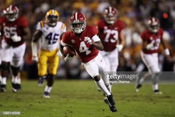 Jerry Jeudy of the Alabama Crimson Tide carries the ball against the LSU Tigers in the second quarter of their game at Tiger Stadium on November 03...