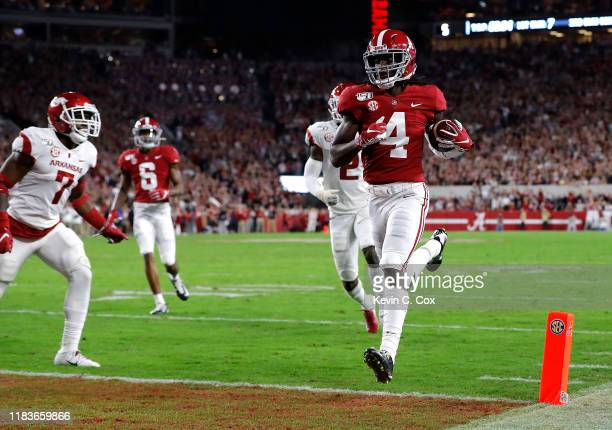 Jerry Jeudy of the Alabama Crimson Tide carries this reception in for a touchdown in the first half against the Arkansas Razorbacks at BryantDenny...