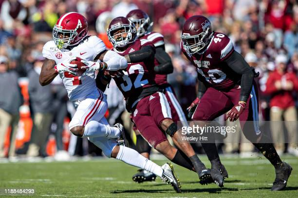 Jerry Jeudy of the Alabama Crimson Tide catches a pass and is chased by Brian Cole II and Erroll Thompson of the Mississippi State Bulldogs at Davis...