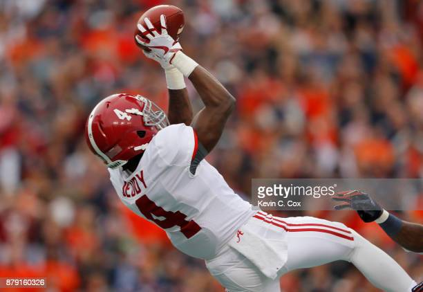 Jerry Jeudy of the Alabama Crimson Tide catches a touchdown pass during the second quarter against the Auburn Tigers at Jordan Hare Stadium on...