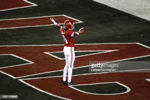 Jerry Jeudy of the Alabama Crimson Tide celebrates his 62 yard touchdown reception thrown by Tua Tagovailoa against the Clemson Tigers during the...