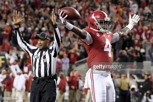 Jerry Jeudy of the Alabama Crimson Tide celebrates his first quarter touchdown reception against the Clemson Tigers the CFP National Championship...