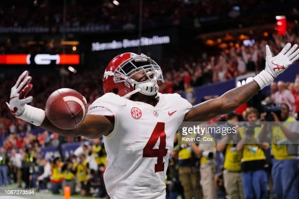Jerry Jeudy of the Alabama Crimson Tide celebrates scoring a touchdown against the Georgia Bulldogs in the fourth quarter during the 2018 SEC...