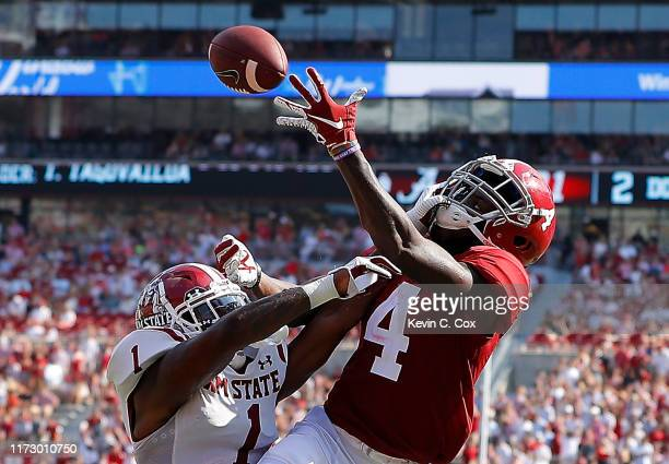Jerry Jeudy of the Alabama Crimson Tide fails to pull in this reception as he is defended by Ray Buford Jr #1 of the New Mexico State Aggies at...