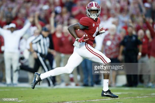 Jerry Jeudy of the Alabama Crimson Tide heads for the end zone with an 81yard touchdown catch and run in the first quarter of the game against the...