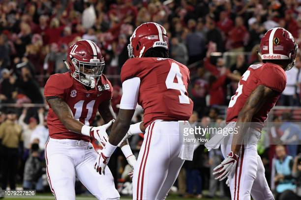 Jerry Jeudy of the Alabama Crimson Tide is congratulated by his teammate Henry Ruggs III after scoring a first quarter touchdown reception against...