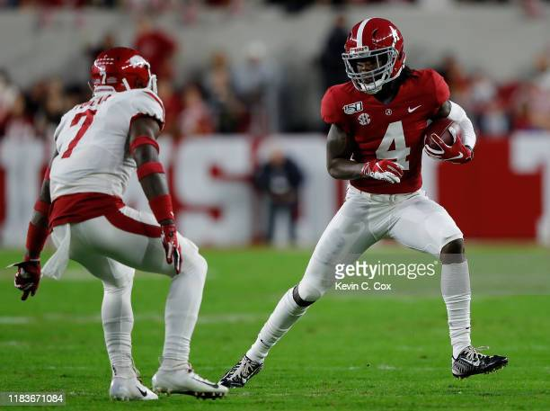Jerry Jeudy of the Alabama Crimson Tide pulls in this reception against Joe Foucha of the Arkansas Razorbacks in the first half at BryantDenny...