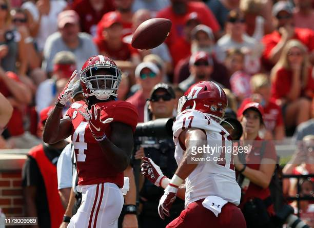 Jerry Jeudy of the Alabama Crimson Tide pulls in this touchdown reception against Jason Simmons Jr #17 of the New Mexico State Aggies at BryantDenny...