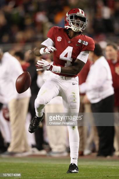 Jerry Jeudy of the Alabama Crimson Tide reacts after making a first down reception against the Clemson Tigers in the CFP National Championship...