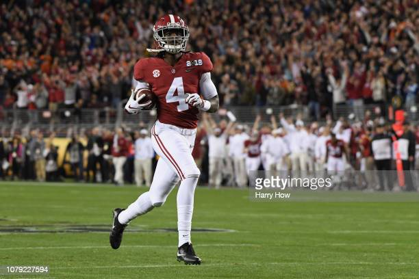 Jerry Jeudy of the Alabama Crimson Tide scores a first quarter touchdown reception against the Clemson Tigers in the CFP National Championship...