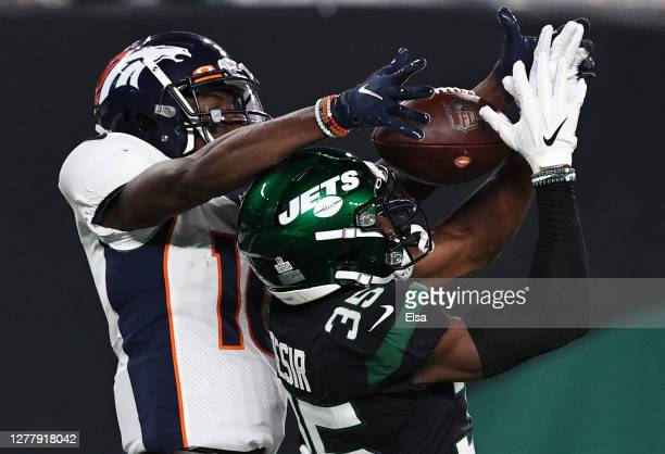 Jerry Jeudy of the Denver Broncos catches a pass for a touchdown against Pierre Desir of the New York Jets during the second quarter at MetLife...