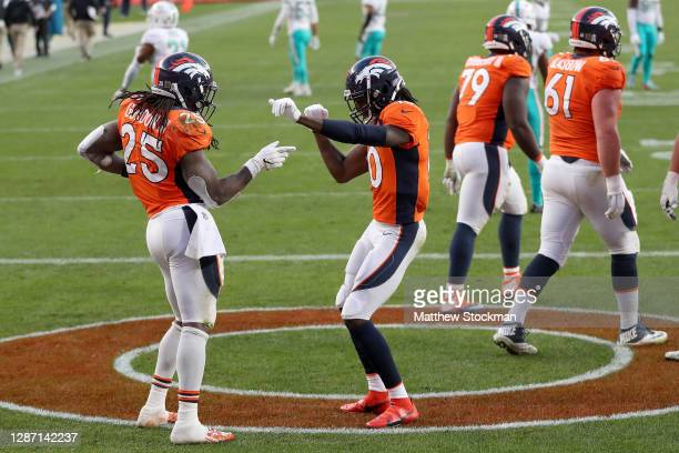 Jerry Jeudy of the Denver Broncos celebrates the touchdown of Melvin Gordon to take a 2010 lead over the Miami Dolphins during the third quarter at...