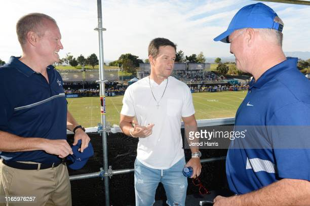 Jerry Jones Jr Mark Wahlberg and Stephen Jones attend The Dallas Cowboys Training Camp to Announce Wahlburgers Opening at The Star in Frisco on...
