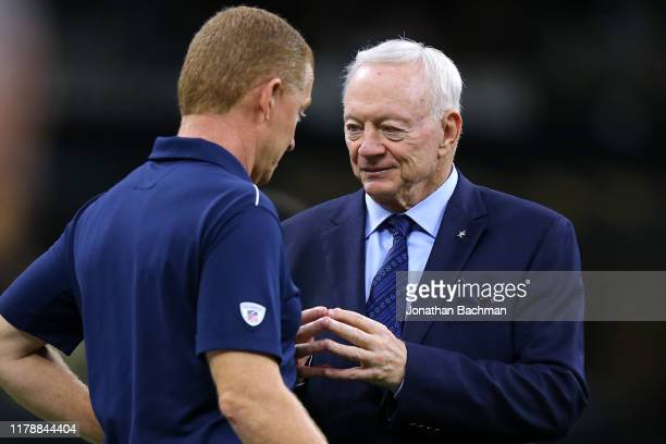 Jerry Jones owner of the Dallas Cowboys talks to head coach Jason Garrett before a game against the New Orleans Saints at the Mercedes Benz Superdome...