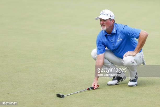 Jerry Kellt lines up his putt on eighteen during the final round of the American Family Insurance Championship Champions Tour golf tournament on June...
