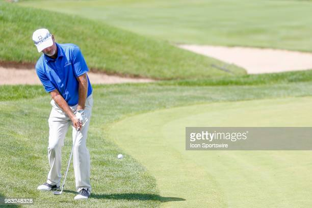 Jerry Kelly chips on to the green at eighteen during the final round of the American Family Insurance Championship Champions Tour golf tournament on...