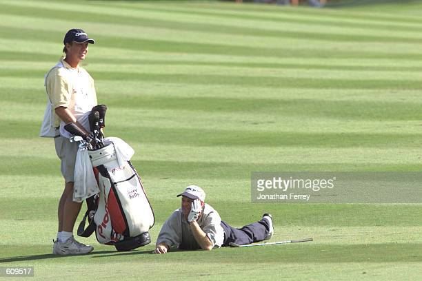 Jerry Kelly lays on the fairway after nearly holing out during the final round of the RenoTahoe Open at the Montreux Golf Club in Reno Nevada DIGITAL...