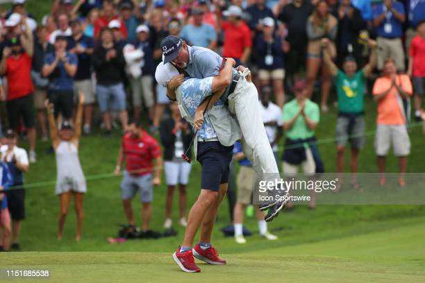 Jerry Kelly of the United States is hugged by his caddy Eric Meller after winning the American Family Insurance Championship on June 23 2019 at...
