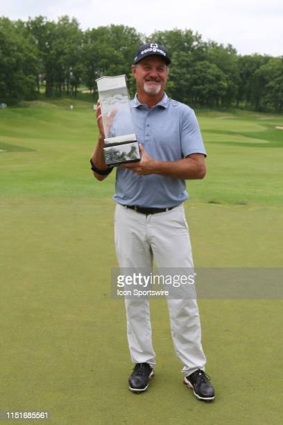 Jerry Kelly of the United States poses with the trophy after winning the American Family Insurance Championship on June 23 2019 at University Ridge...