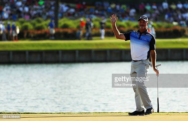 Jerry Kelly of the United States reacts to his birdie putt on the 16th green during the third round of THE PLAYERS Championship at the Stadium course...