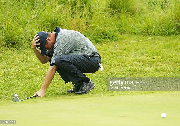 Jerry Kelly of USA reacts to a putt on the 14th hole during his match against KJ Choi of Korea and Peter Lonard of Australia during the second round...
