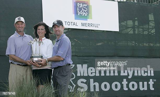 Jerry Kelly Paula Polito of Merrill Lynch and Rod Pampling hold the trophy after the third and final round of the Merrill Lynch Shootout at the...