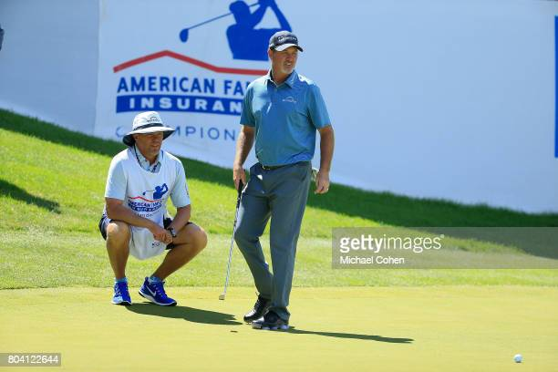 Jerry Kelly reacts to a missed birdie putt during the second round of the American Family Insurance Championship held at University Ridge Golf Course...