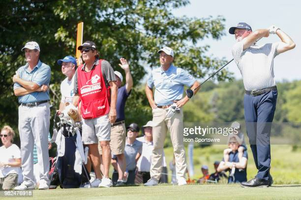 Jerry Kelly tees off on the second tee while Jerry Smith and Doug Garwood look on during the American Family Insurance Championship Champions Tour...