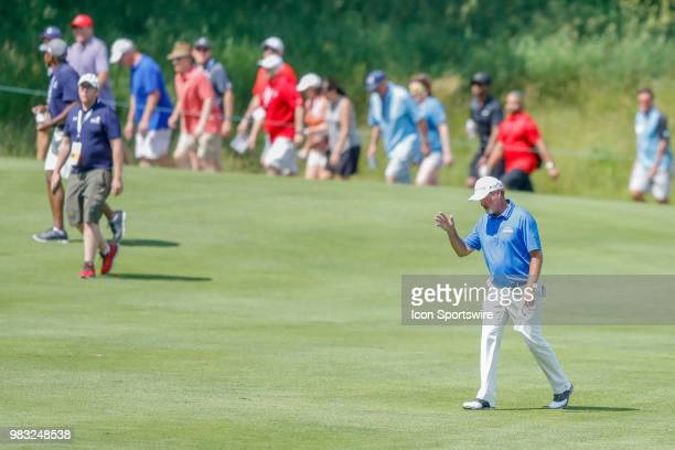 Jerry Kelly waves to the crowd on eighteen during the final round of the American Family Insurance Championship Champions Tour golf tournament on...