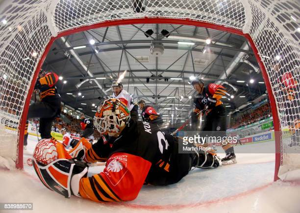 Jerry Kuhn goaltender of Wolfsburg makes a save on Patrik Lamper of Bystrica during the Champions Hockey League match between Grizzlys Wolfsburg and...