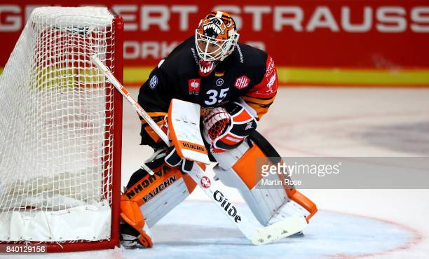 Jerry Kuhn goaltender of Wolfsburg tends net against Banska Bystrica during the Champions Hockey League match between Grizzlys Wolfsburg and HC05...