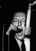 Jerry lee lewis performs on stage singing into two microphones at the picture id106882898?s=170x170