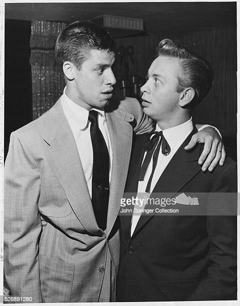 Jerry Lewis and Mel Torme pose with their arms around each other at Ciro's in Hollywood The two met at the club to watch a performance by Sophie...