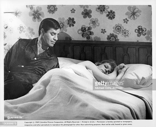 Jerry Lewis gets ready to join Anne Frances in bed in a scene from the film 'Hook Line and Sinker' 1969