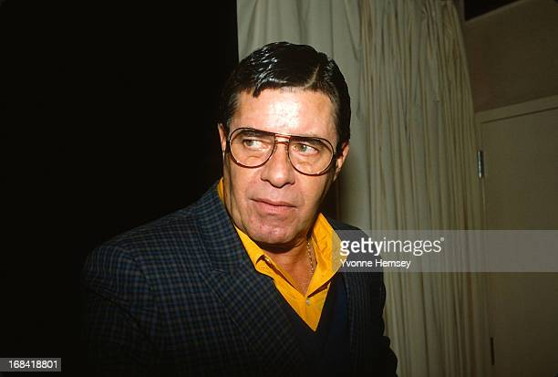 Jerry Lewis is photographed leaving a press conference October 16 1986 in New York City to announce the discovery of the mutated gene that causes...