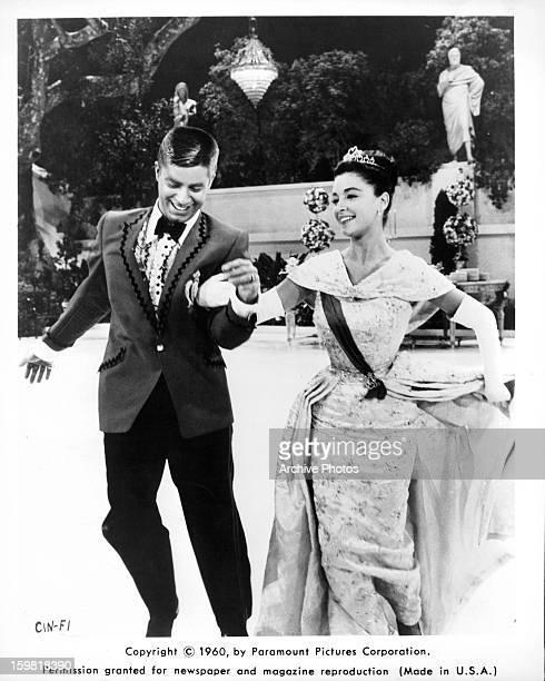 Jerry Lewis runs with Anna Maria Alberghetti in a scene from the film 'Cinderfella' 1960