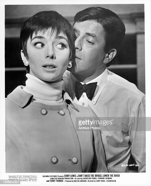 Jerry Lewis sneaking up behind Jacqueline Pearce in a scene from the film 'Don't Raise The Bridge Lower The River' 1968