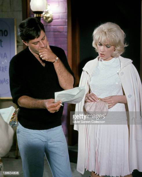 Jerry Lewis US actor and comedian and Stella Stevens US actress both looking at a piece of paper held by Lewis in a publicity image issued for the...