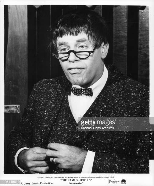 Jerry Lewis with glasses bow tie and buck teeth in a scene from the film 'The Family Jewels' 1965