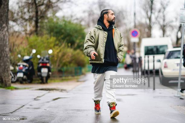 Jerry Lorenzo Fear of God founder wears a green bomber jacket white pants outside Dior during Paris Fashion Week Menswear Fall Winter 20182019 on...