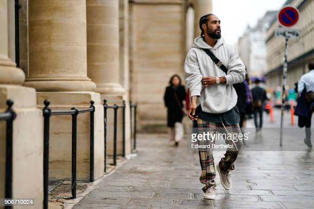 Jerry Lorenzo Fear of God founder wears a white hoodie sweater checked pants sneakers outside Louis Vuitton during aris Fashion Week Menswear Fall...