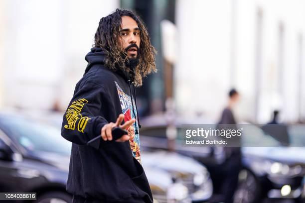 Jerry Lorenzo Founder of Fear of God wears a Spaghetti Boys black hoodie sweater outside Haider Ackermann during Paris Fashion Week Womenswear...