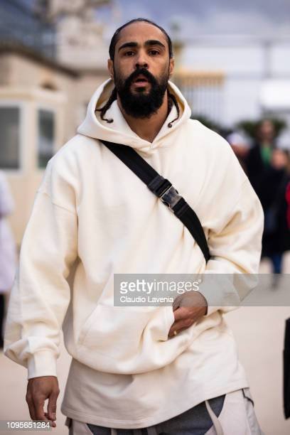 Jerry Lorenzo wearing a white sweatshirt is seen in the streets of Paris before the Louis Vuitton show on January 17 2019 in Paris France