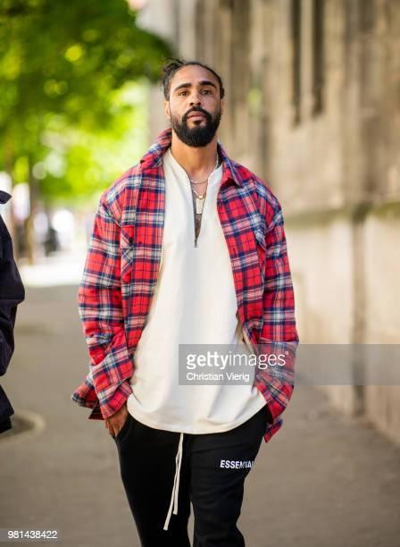 Jerry Lorenzo wearing lumberjack plaid jacket is seen outside Maison Margiela on day four of Paris Fashion Week Menswear SS19 on June 22 2018 in...
